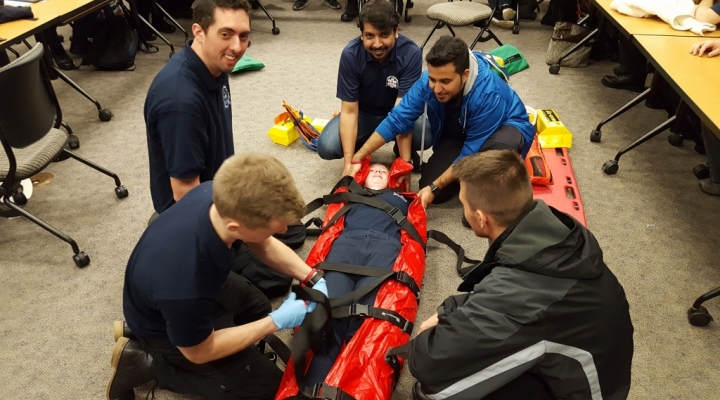 Image of students using a vacuum mattress splint